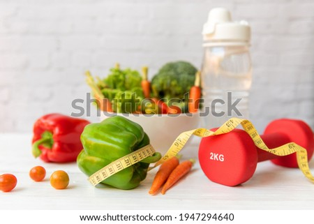 Diet Healthy food and lifestyle health concept. Sport exercise equipment workoutandgym background with nutrition detox salad for fitness style. Health care Concept Photo stock ©
