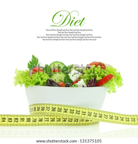 Diet meal. Vegetables salad in a bowl with measuring tape