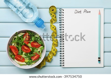 Diet plan, menu or program, tape measure, water and diet food of fresh salad on blue background, weight loss and detox concept, top view