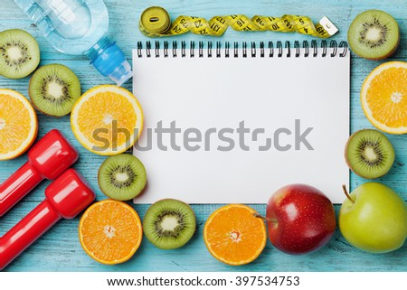 Diet plan, menu or program, tape measure, water, dumbbells and diet food of fresh fruits on blue background, weight loss and detox concept, top view