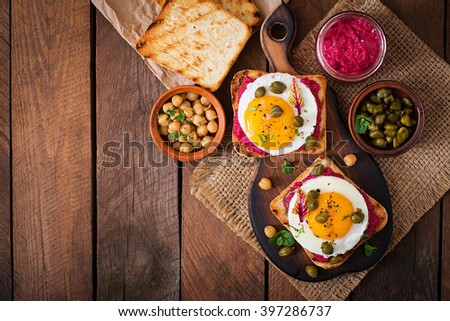 Diet sandwiches with beet root hummus, capers and egg. Top view #397286737