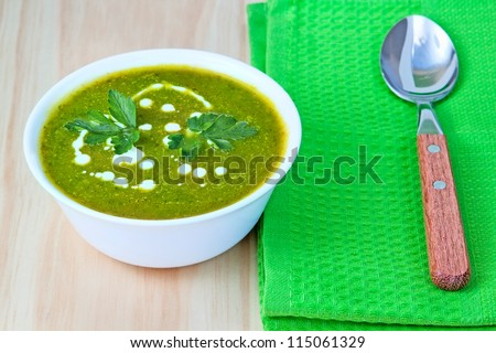 Diet soup with a spoon on a green napkin.