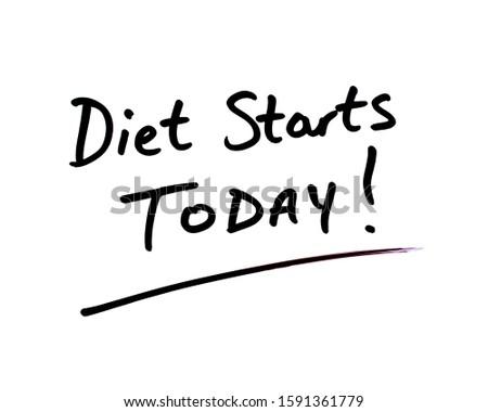Diet Starts Today! message handwritten on a whiteboard.