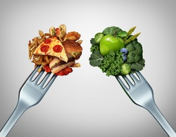 Diet struggle and decision concept and nutrition choices dilemma between healthy good fresh fruit and vegetables or cholesterol rich fast food with two dinner forks competing to decide what to eat.
