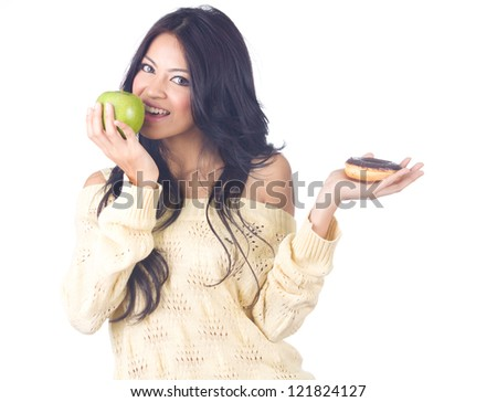 Diet woman holding apple and donut on white background