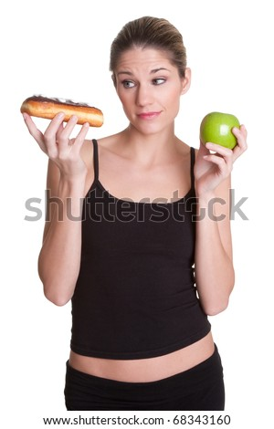 Diet woman holding donut apple