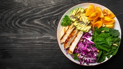 Dietary menu. Healthy salad Purple cabbage avocado, spinach, tomatoes, fillets and nuts. Keto Paleo diet menu. banner, menu, recipe, place for text. Top view.