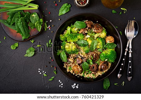Dietary menu. Healthy vegan salad of vegetables - broccoli, mushrooms, spinach and quinoa in a bowl. Flat lay. Top view #760421329