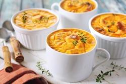 Dietetic food. Four servings of carrot flan. Focus selective