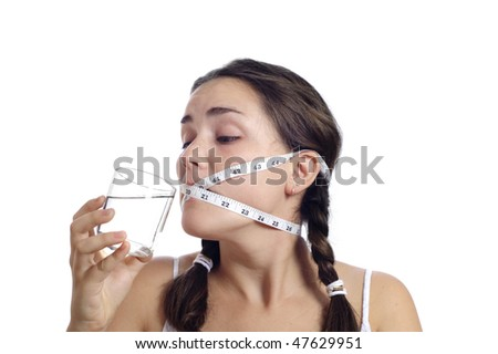 Dieting concept, cute girl had her mouth closed by measuring tape.