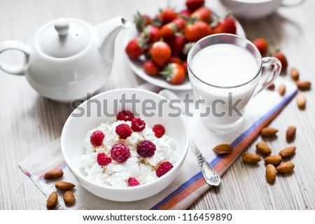 dieting cottage cheese with fresh raspberry, tea and almonds