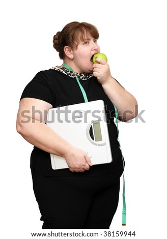 dieting overweight women with scales and apple
