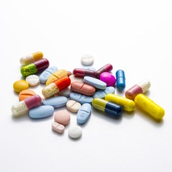 diferent Tablets pills capsule heap mix therapy drugs doctor flu antibiotic pharmacy medicine medical