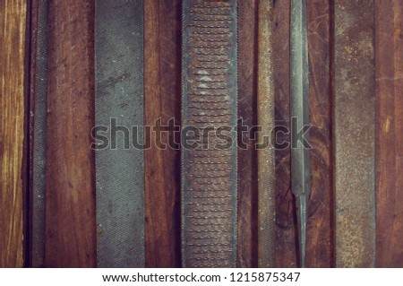 differen trasp of old years.file of round shape, rectangular shape, triangular shape lying on a wooden table #1215875347