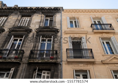Difference between wash cleaned building house facade and a dirty one in town center