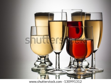 difference glasses of wine on white background