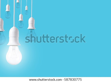 difference light bulb on blue background. concept of new ideas with innovation and creativity. #587830775