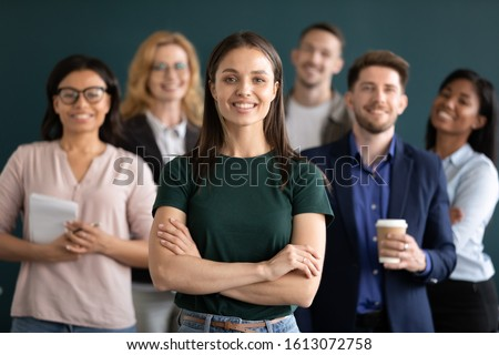 Different age and ethnicity businesspeople standing behind of female company chief business owner with hands crossed posture of confident independent businesswoman leader of multi-ethnic team concept Stock photo ©