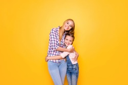 Different age cute niece feelings relatives youth generation concept. Portrait of sweet lovely joyful beautiful girl with pigtails denim outfit hugging pretty aunt isolated on bright vivid background