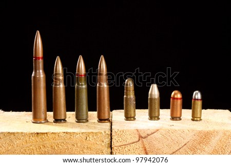 Different ammo close up over black background