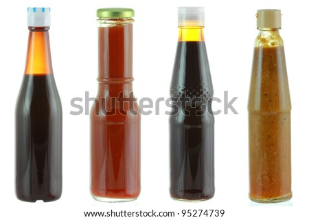 Different bottles of sauce - Oyster sauce, Tomato sauce, Dark soy sauce, Salted soya beans.. isolated on white