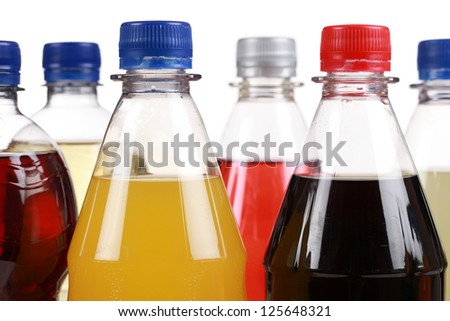 Different bottles with soda isolated on white background