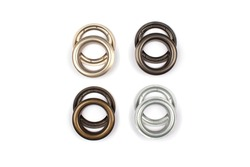 Different brass multicoloured metal eyelets or rivets - curtains rings for fastening fabric to the cornice, isolated on white background with copyspace for text. Catalogue photo, selective focus