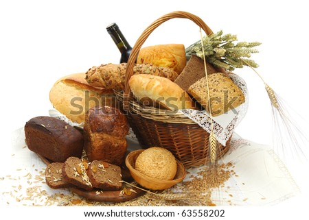 Different bread products and bottle of red wine in a basket