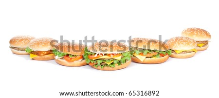 different burgers arrangement isolated on white