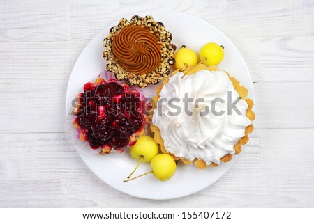 Different cake in a plate on table. Top view