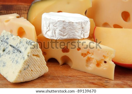different cheeses served on wooding cutting board
