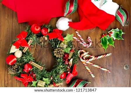 Different Christmas elements are displayed on the wooden kitchen table