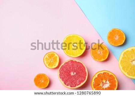 Different citrus fruits on color background, flat lay. Space for text #1280765890