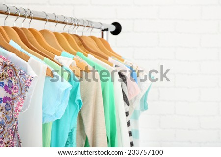 Different clothes on hangers close up #233757100