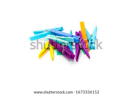 Photo of  Different Clothespins on white background