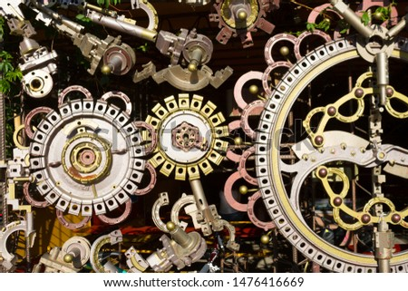 Different cogwheels in some mechanical device background