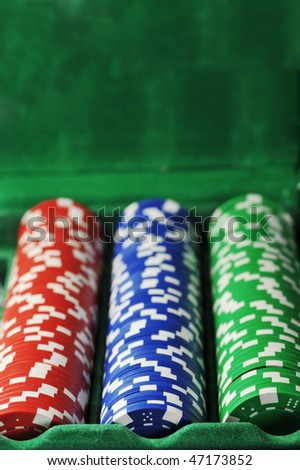 different color chips for gambling in box background.