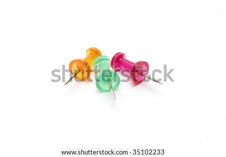 Different color drawing-pins on white background