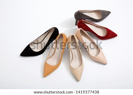373268759 different color of 3 inch high heel shoes in white background