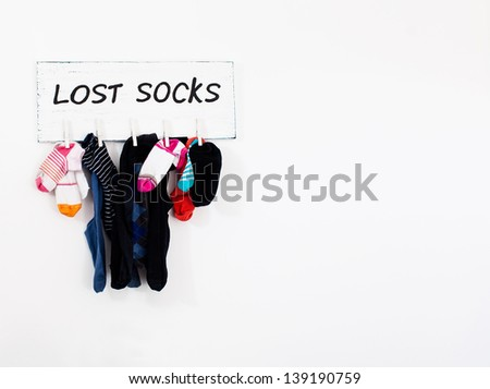 different color socks hang on rope