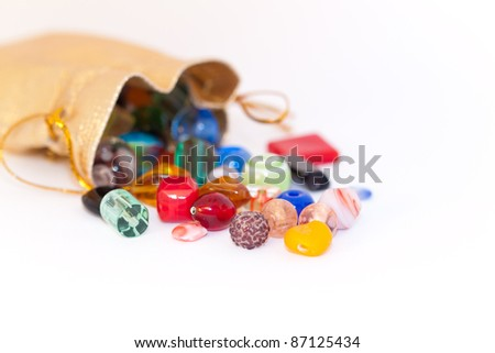 Different colored beads isolated on white.