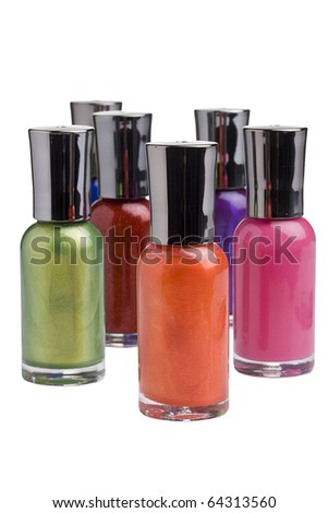 Different colored nail polish bottles placed in front of a white background.