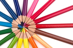 Different colored pencils in a formation.