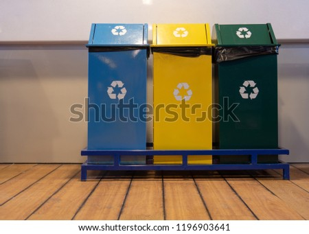 Different Colored Recycle Bins For Collection Of Recycle Materials