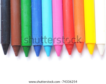 different colored wax crayons isolated on white background