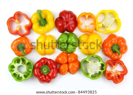 Different colorful pepper slices on white background