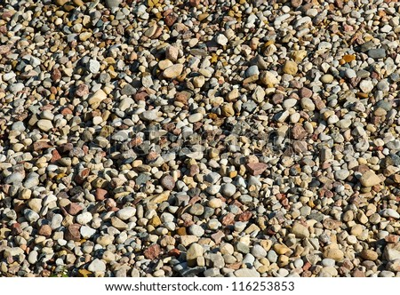 Different colors gravel background, rock pieces texture, natural background, stones texture, granite. Contrast photo. Material. Ground.