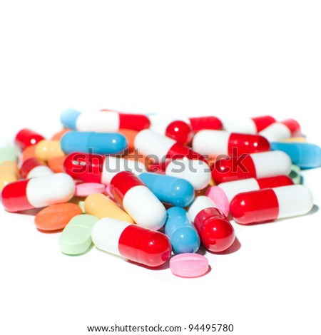 different colors of  pills and capsule isolated on white