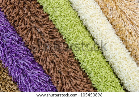 different colourful artificial shaggy carpet samples, closeup - stock photo