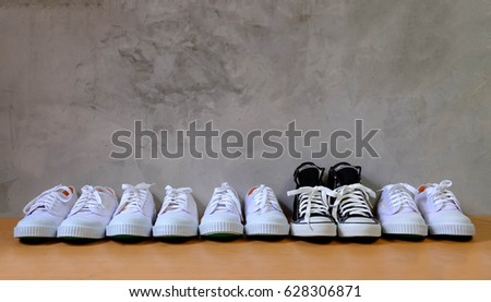 different concept with Black shoes in white shoes